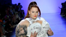 Plus-size model Tess Holliday takes to NYFW catwalk in a statement 'sample size' dress