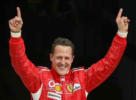 Ferrari Formula One driver Michael Schumacher of Germany celebrates after taking the pole position a..
