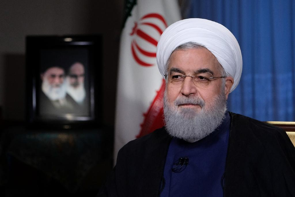 Iran's President Hassan Rouhani, who has come under attack from all sides, gives an interview to Iranian television (AFP Photo/-)