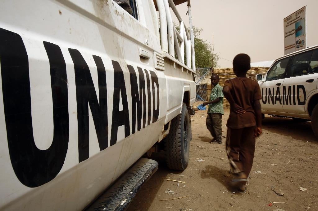 What are some negative aspects of helping Darfur?
