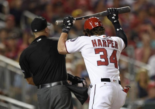 Bryce Harper reacts after he was ejected from Wednesday's game against the Brewers by home plate umpire Chris Segal. (AP)
