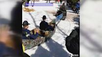 Michigan State Troopers go for canoe ride in the snow