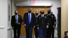 Trump wears mask in public setting for the first time during visit to hospital