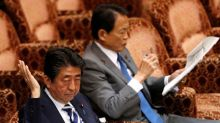 Japan PM takes blame for loss of trust over scandal as polls dive, denies involvement