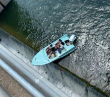 Unnerving video shows moment boaters almost fall off edge of Texas dam