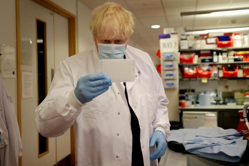 FILE PHOTO: Britain's Prime Minister Boris Johnson visits the Jenner Institute in Oxford