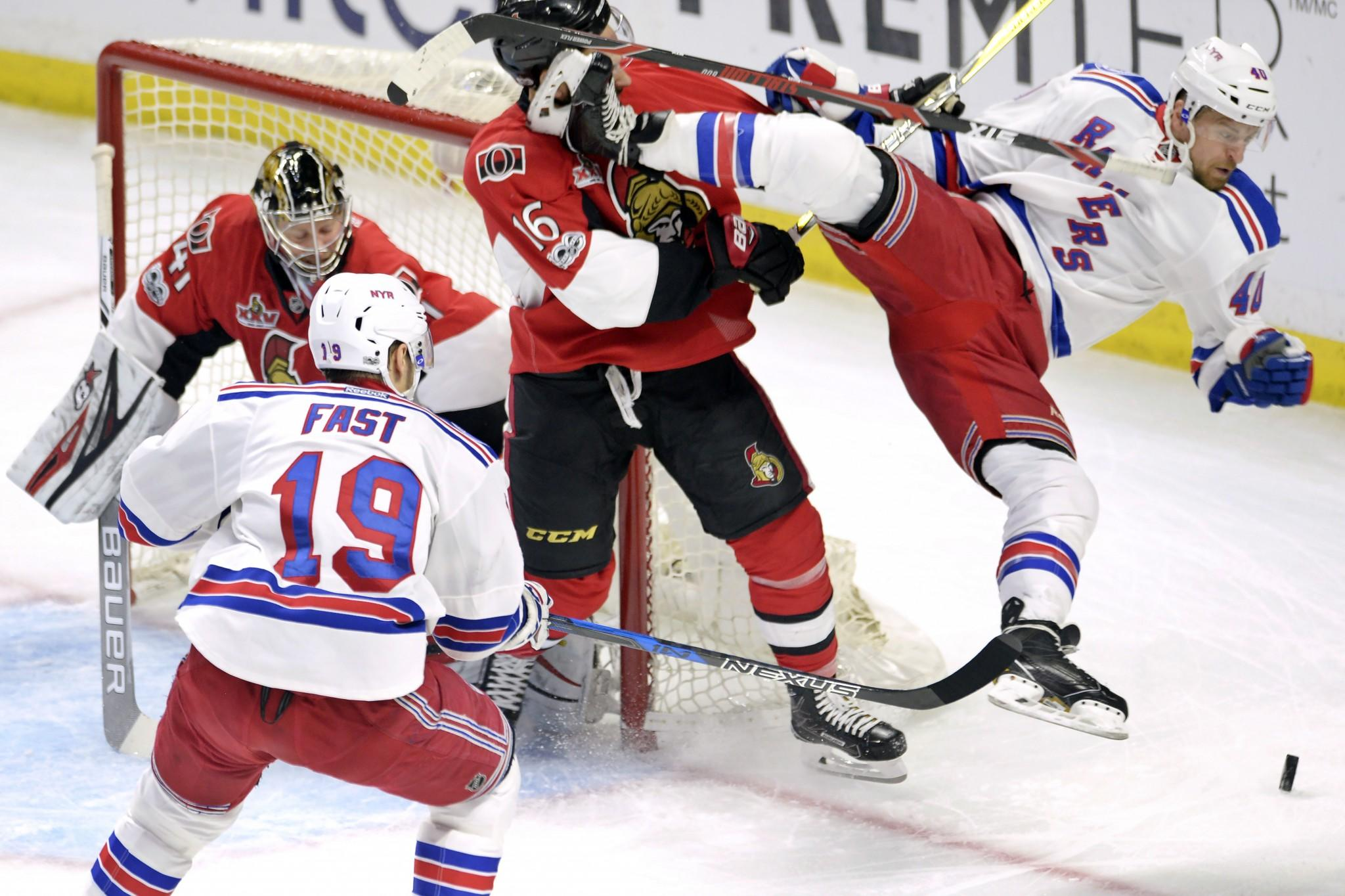 <p>Ottawa Senators left wing Clarke MacArthur (16) hits New York Rangers right wing Michael Grabner, right, as Senators goalie Craig Anderson (41) and Rangers right wing Jesper Fast (19) looks on during the first period in Game 5 in the second-round of the Stanley Cup playoffs in Ottawa on May 6, 2017. (Adrian Wyld/The Canadian Press/AP) </p>