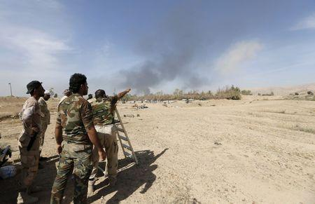Shi'ite fighters gather to fight against Islamic State militants in al-Fatha, northeast of Baiji