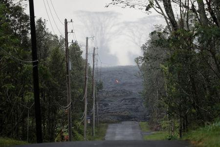 The Kilauea lava flow cuts off Kahukai Street, in the Leilani Estates near Pahoa, Hawaii, U.S., May 29, 2018. REUTERS/Marco Garcia