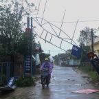 Vietnam troops hunts for survivors after typhoon kills 31