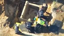 Construction worker dies after falling into trench despite desperate efforts to save him