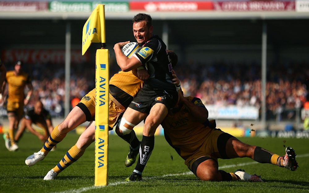 Phil Dollman is prevented from touching down by Jamal Ford-Robinson and Max Crumpton - Getty Images Europe