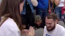 Fan who lost his mind during marriage proposal at a basketball game gets invite to couple's wedding