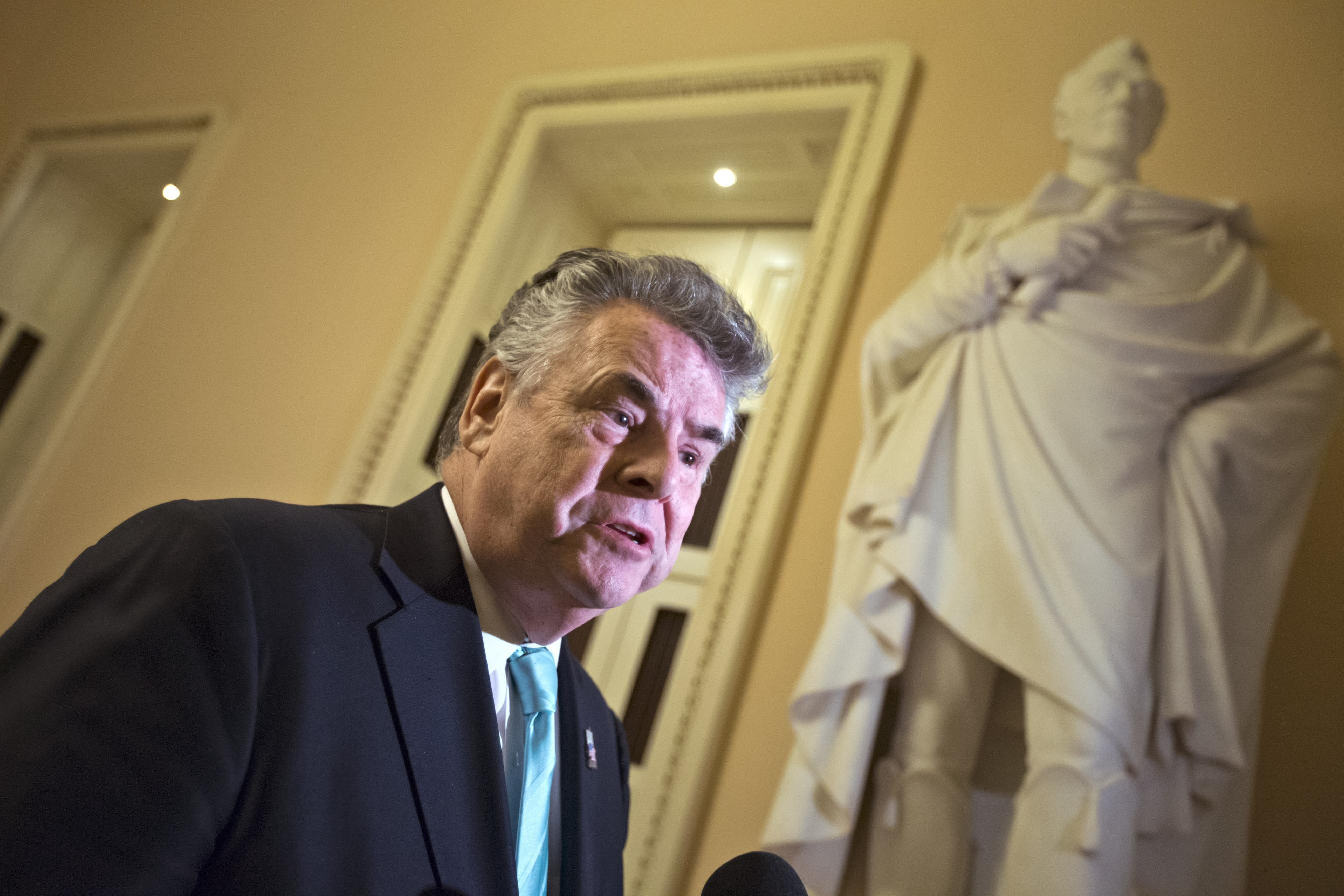 Rep. Peter King, R-N.Y., speaks to reporters after appearing before the House Rules Committee to work on an aid package to assist victims of Superstorm Sandy on Monday, Jan. 14, 2013, at the Capitol in Washington. The House is expected to vote on the bill Tuesday. (AP Photo/J. Scott Applewhite)