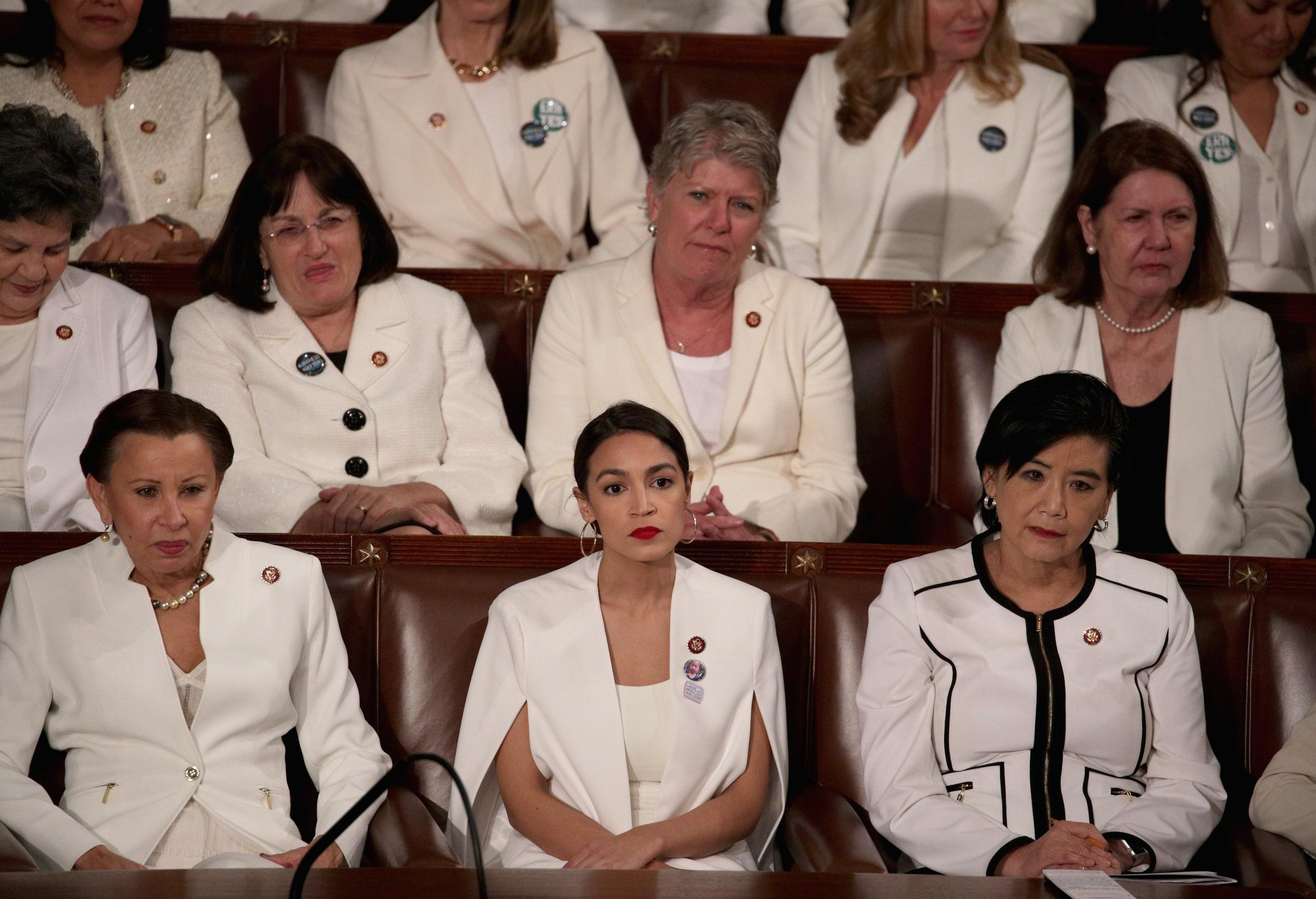 WASHINGTON, DC - FEBRUARY 05:  Rep. Alexandria Ocasio-Cortez (D-NY) watches President Donald Trump's State of the Union address in the chamber of the U.S. House of Representatives at the U.S. Capitol Building on February 5, 2019 in Washington, DC. A group of female Democratic lawmakers chose to wear white to the speech in solidarity with women and a nod to the suffragette movement.  (Photo by Alex Wong/Getty Images)