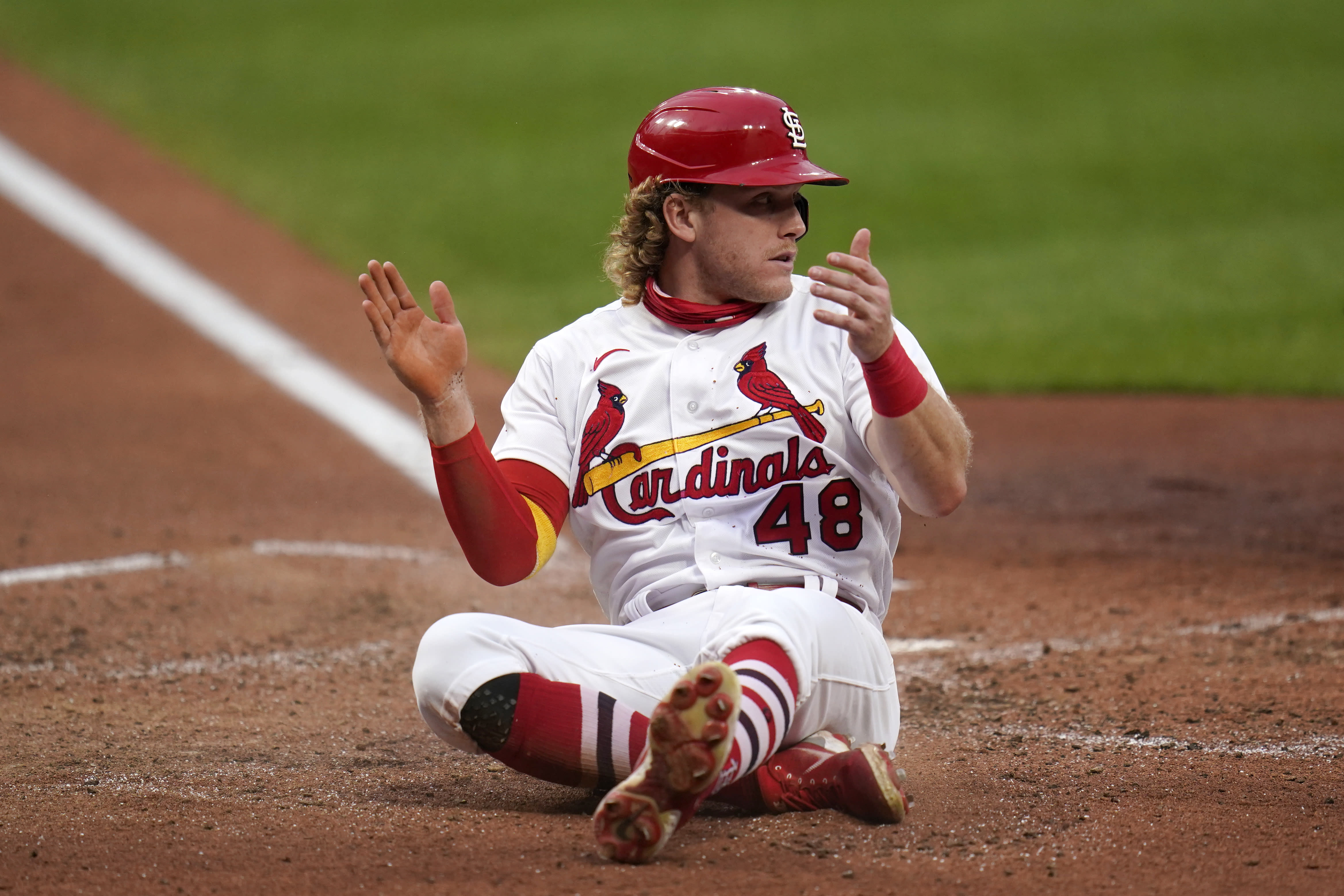 St. Louis Cardinals' Harrison Bader celebrates after scoring during the third inning in the second game of a baseball doubleheader against the Minnesota Twins Tuesday, Sept. 8, 2020, in St. Louis. (AP Photo/Jeff Roberson)