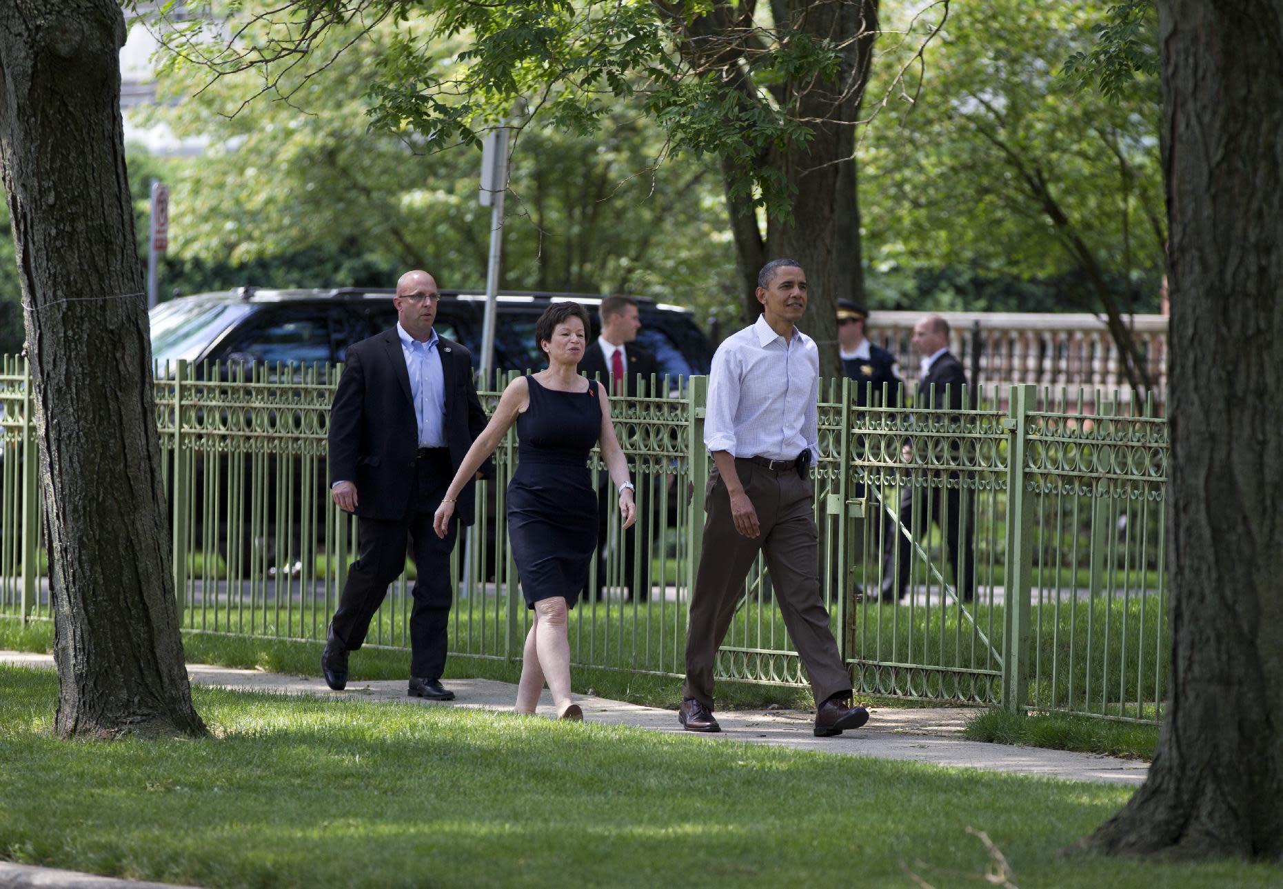 President Barack Obama walks through his Hyde Park neighborhood with senior advisor Valerie Jarrett to his friend, Marty Nesbitt's home, Saturday, June 2, 2012, in Chicago. (AP Photo/Carolyn Kaster)