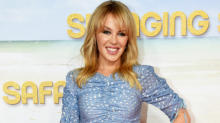 Petite Kylie Minogue Pulled Off a Height-Illusion Trick With Flirty Heels and a Pose Perfected By Greek Goddesses