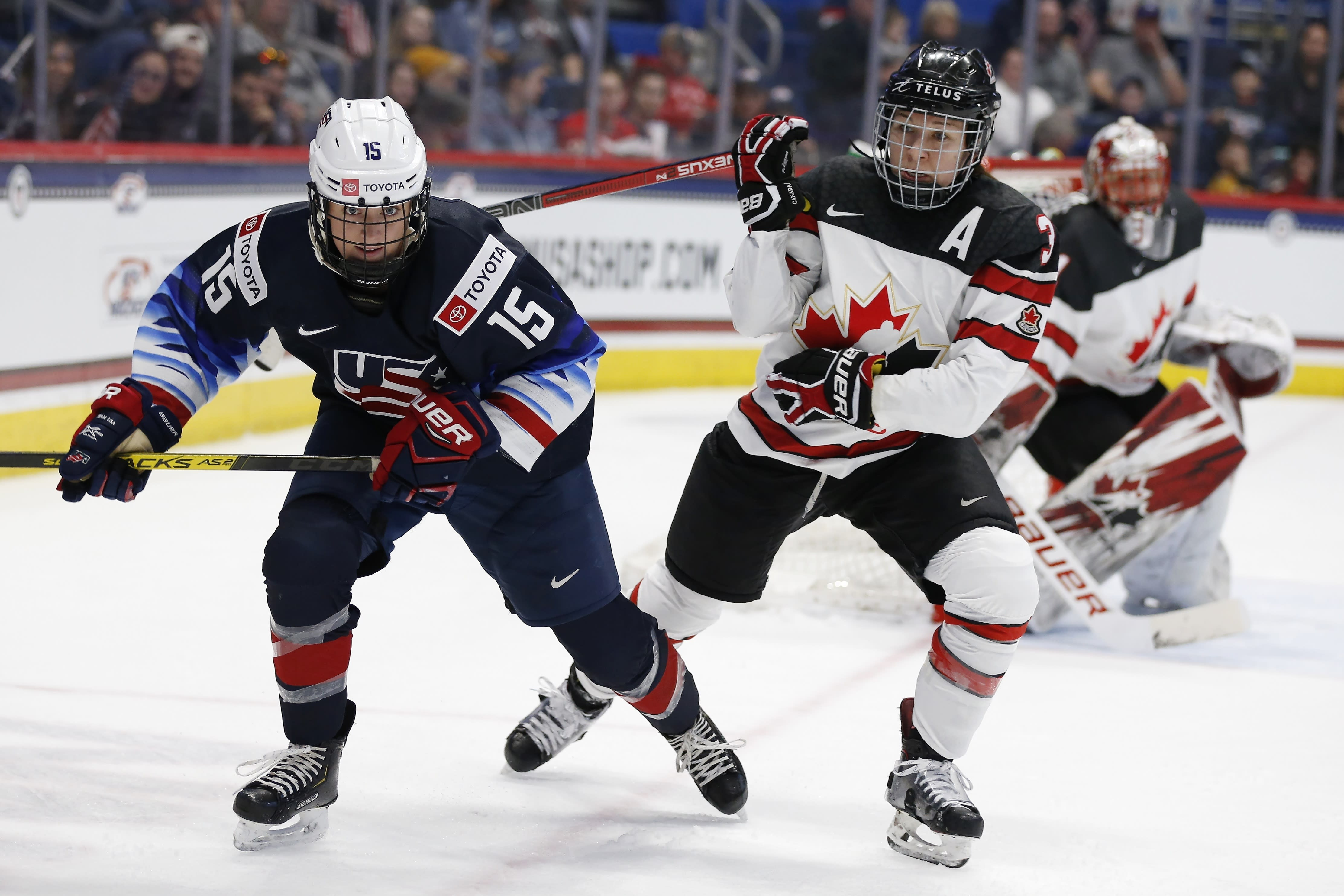 Canada's Jocelyne Larocque (3) defends against United States' Sydney Brodt (15) during the first period of a rivalry series women's hockey game in Hartford, Conn., Saturday, Dec. 14, 2019. (AP Photo/Michael Dwyer)