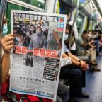 Apple Daily: Hong Kong opposition newspaper 'fights on' after founder arrested