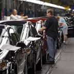 General Motors' profit falls from a year ago but beats the Street