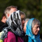 New Zealand marks one week since mosque attack with prayers, scarves