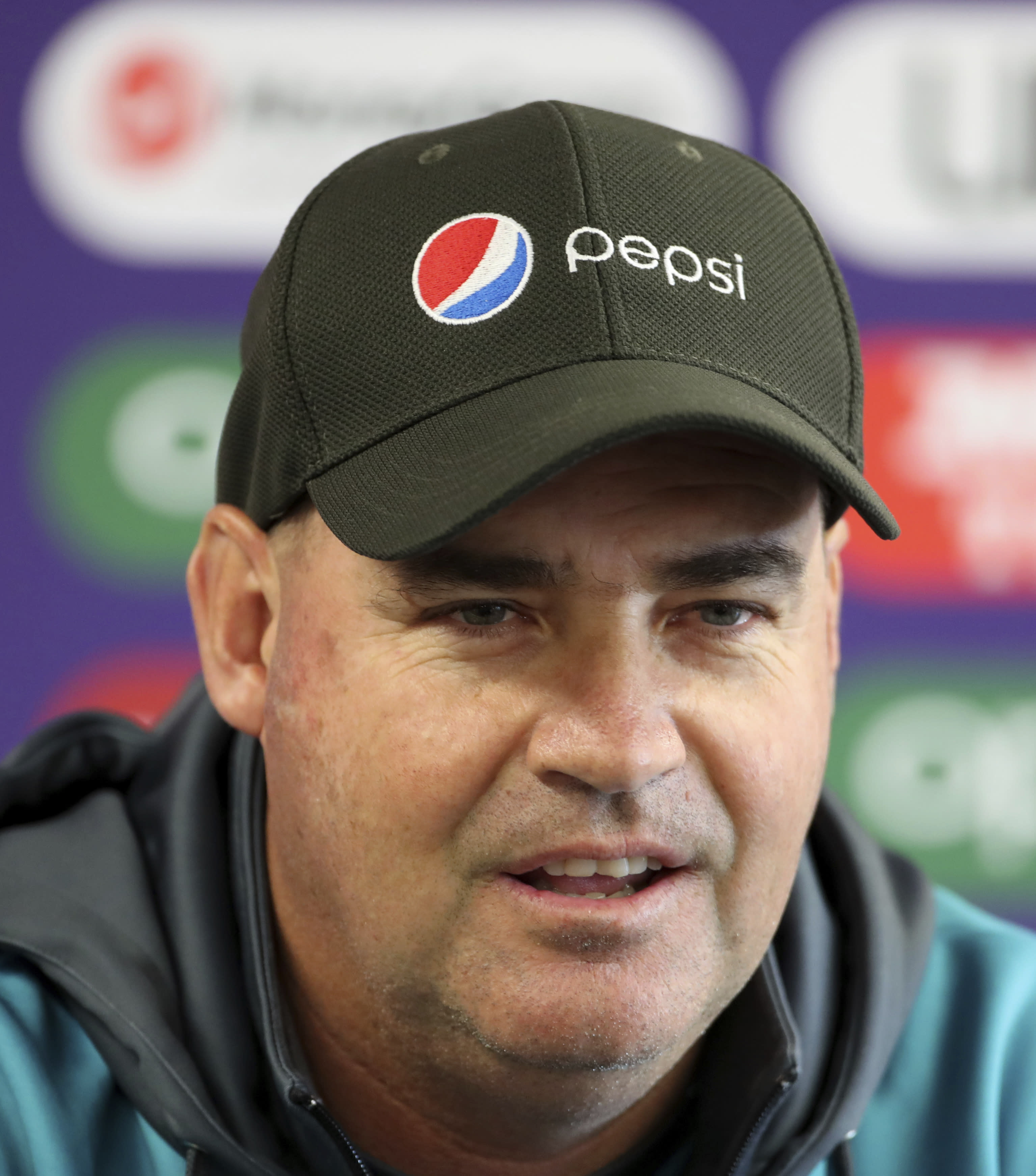 Pakistan's coach Mickey Arthur speaks during a press conference ahead of their Cricket World Cup match against India at Old Trafford in Manchester, England, Saturday, June 15, 2019. (AP Photo/Aijaz Rahi)