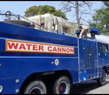 Authorities in southern India use water cannons to disinfect roads during coronavirus outbreak