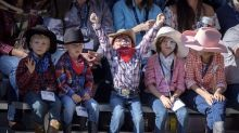 PHOTOS: Calgary Stampede kicks off with horses, hats and smiles