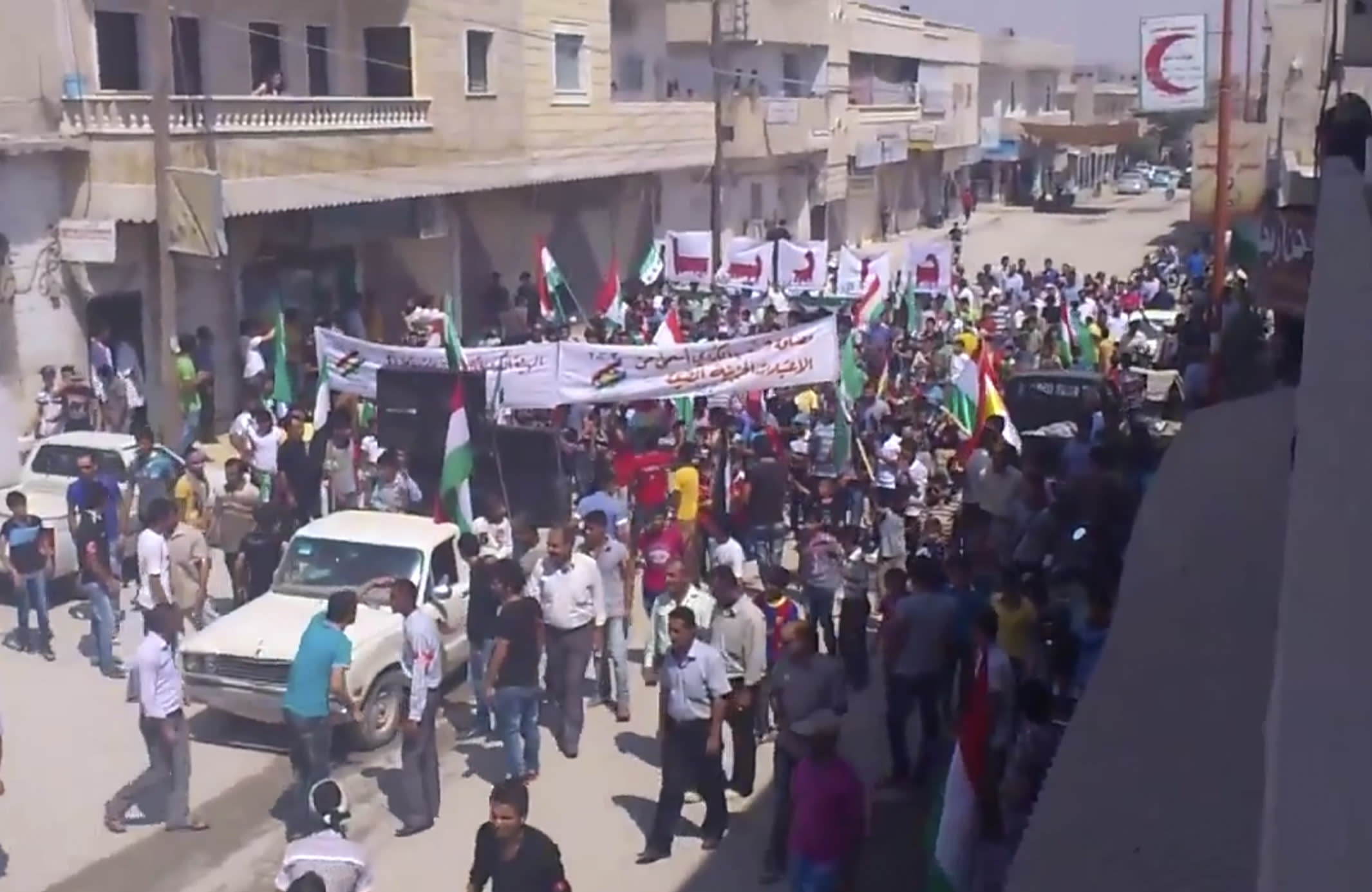 This image made from video provided by Shaam News Network (SNN) and accessed via AP video purports to show a demonstration in Aleppo, Syria, Friday, Aug. 31, 2012. Syrian rebels have begun a major operation in the Aleppo region, aiming to strike at security compounds and bases around Syria's largest city, activists said Friday. It would be evidence that weeks of intense bombardments by the Syrian military, including airstrikes, have failed to dislodge the rebels. Instead, fighting rages across the country in a 17-month civil war that shows no sign of ending soon. (AP Photo/Shaam News Network SNN via AP video) THE ASSOCIATED PRESS HAS NO WAY OF INDEPENDENTLY VERIFYING THE CONTENT, LOCATION OR DATE OF THIS PICTURE.