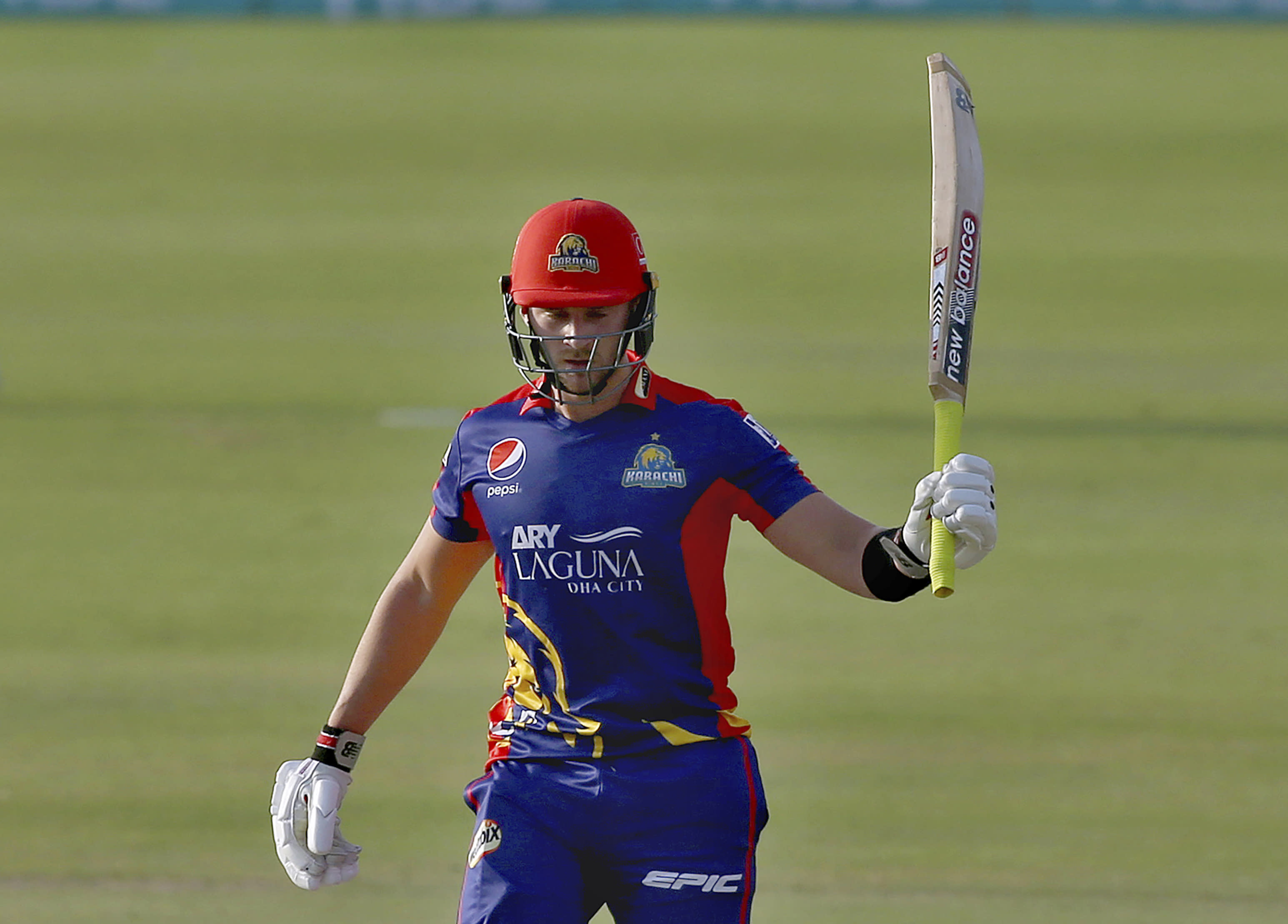 Karachi Kings' Joe Clarke raises bat to celebrate after scoring fifty during a Pakistan Super League T20 cricket match between Karachi Kings and Multan Sultans at the National Stadium, in Karachi, Pakistan, Saturday, Feb. 27, 2021. (AP Photo/Fareed Khan)