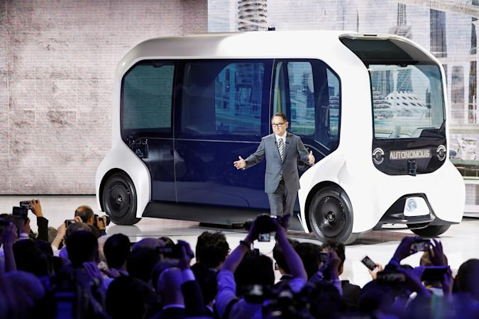 Toyota Motor Corporation President Akio Toyoda, shows the e-Palette autonomous concept vehicle   at the Tokyo Motor Show, in Tokyo, Japan October 23, 2019. REUTERS/Edgar Su