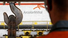 ArcelorMittal cuts steel demand forecast, targets asset sales