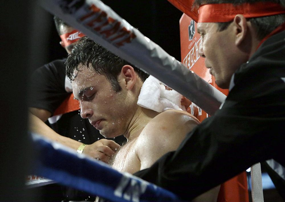 Julio Cesar Chavez Jr. sits in his corner after the sixth round of a 10-round boxing match between Chavez, the former World Boxing Council (WBC) middleweight champion, and Brian Vera, the contender, in Carson, Calif., Saturday, Sept. 28, 2013. Chavez won in a unanimous decision