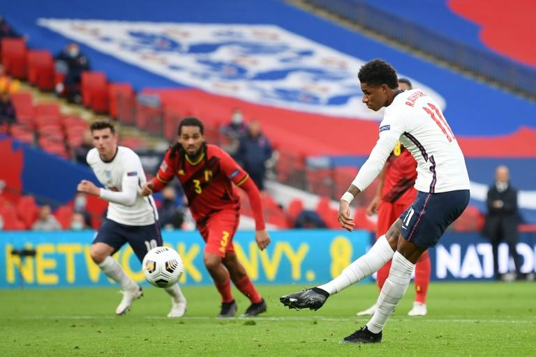 Spot on: Marcus Rashford equalised for England from the penalty spot