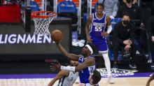 Spurs hold off Kings 113-104 to end five-game slide