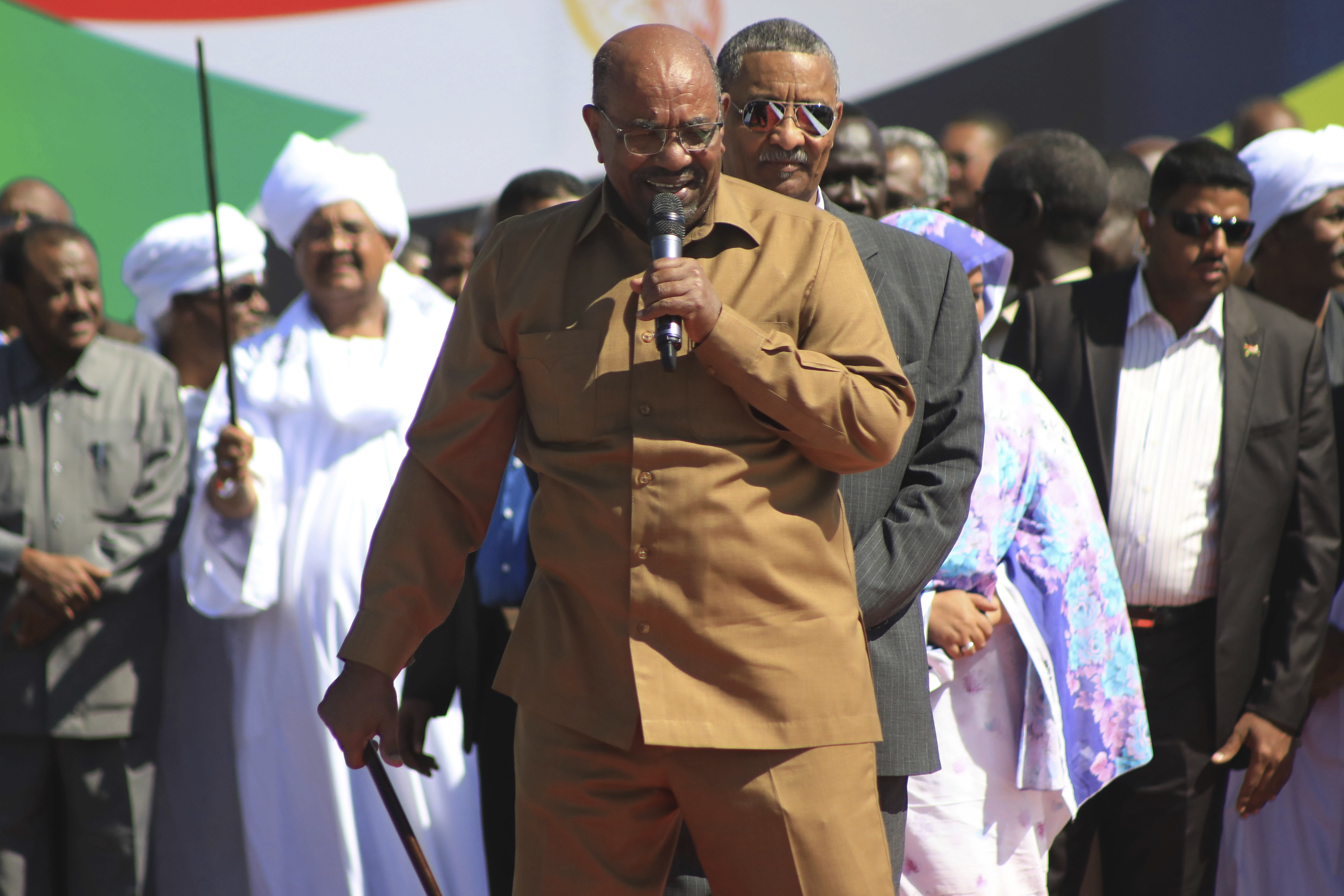 """Sudan's President Omar al-Bashir addresses supporters at a rally in Khartoum, Sudan, Wednesday, Jan. 9, 2019. Al-Bashir told the gathering of several thousands of supporters in the capital that he is ready to step down only """"through election."""" The remarks come after three weeks of anti-government protests. (AP Photo/Mahmoud Hjaj)"""