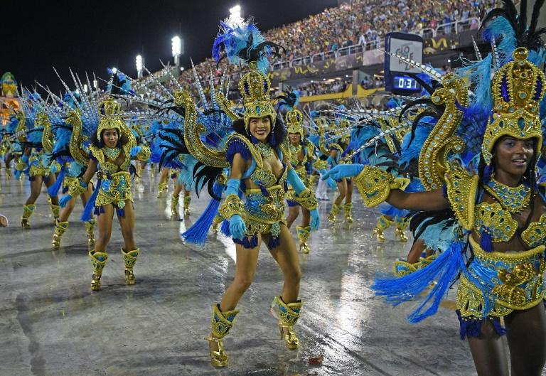 Rio's carnival, famous for its Samba dancers, drummers and dancing crowds, draws millions for all night parties in packed streets
