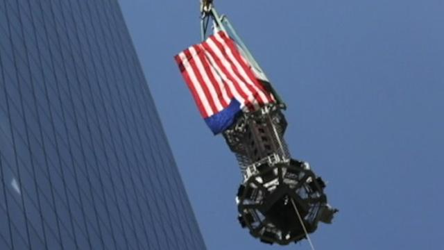 Instant Index: Draped in the American Flag, WTC Spire Brought to Top