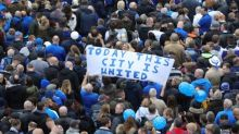 Leicester City fans walk to honour chairman