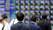 Wall Street futures, dollar dip after U.S. government shutdown, Asia resilient