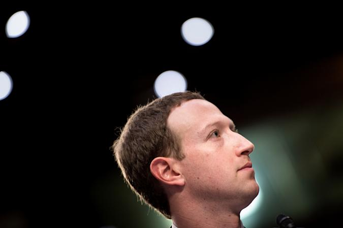 """Facebook CEO Mark Zuckerberg listens during a joint hearing of the Senate Commerce, Science and Transportation Committee and Senate Judiciary Committee on Capitol Hill April 10, 2018 in Washington, DC. Facebook chief Mark Zuckerberg took personal responsibility Tuesday for the leak of data on tens of millions of its users, while warning of an """"arms race"""" against Russian disinformation during a high stakes face-to-face with US lawmakers. / AFP PHOTO / Brendan Smialowski        (Photo credit should read BRENDAN SMIALOWSKI/AFP via Getty Images)"""