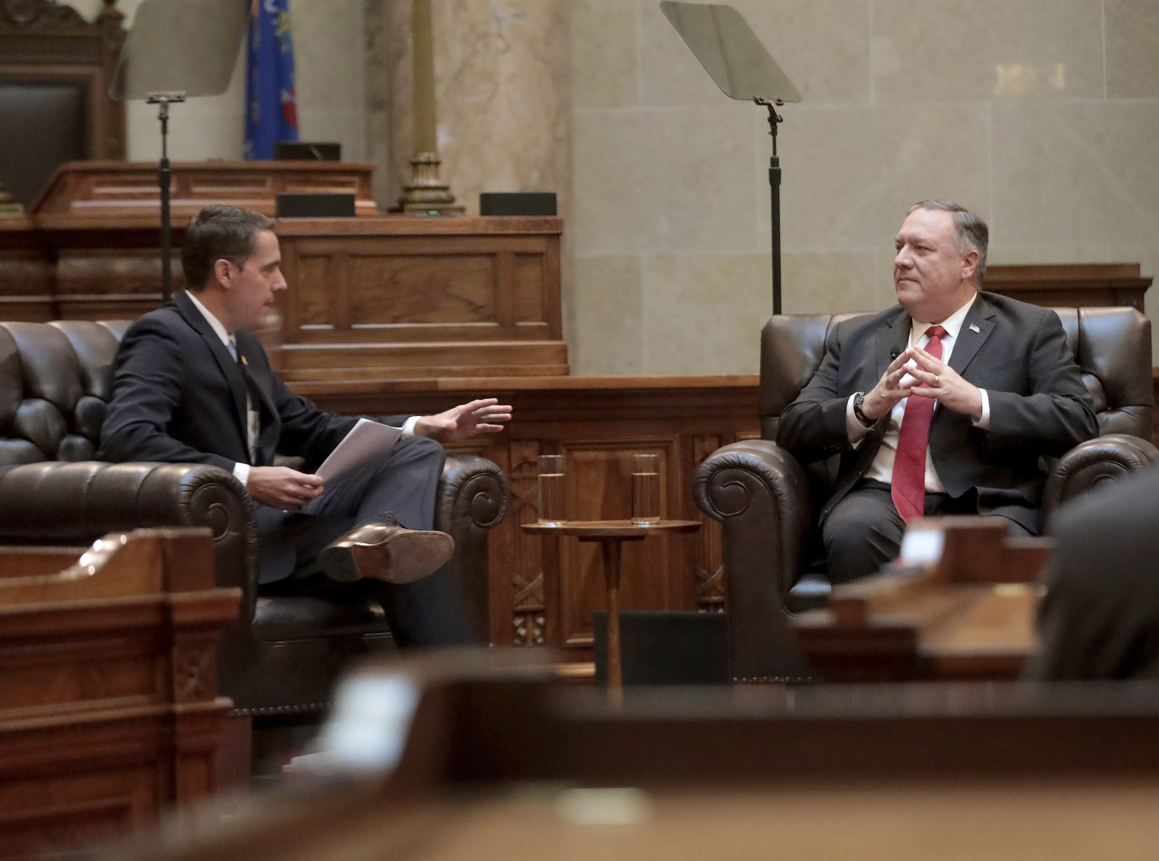 Secretary of State Mike Pompeo , right, listens to a question from Wisconsin Senate President Roger Roth, R-Appleton, during a question and answer sessions with state Republican legislators in the Senate chamber of the Wisconsin State Capitol in Madison, Wis. Wednesday, Sept. 23, 2020. (John Hart/Wisconsin State Journal via AP)