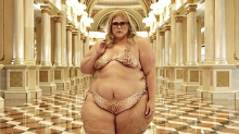 Plus-size blogger wearing a bikini is told to 'cover up'