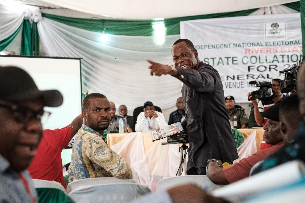Tension: Party representatives argue over the vote count at a collation centre at Port Harcourt, Nigeria's oil hub (AFP Photo/Yasuyoshi CHIBA)