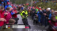 Officer body checks fan at Road World Cycling Championships