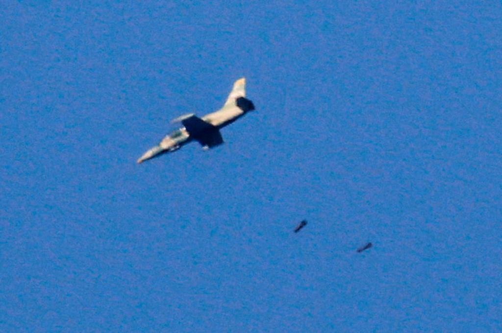 A picture taken on July 23, 2018 from the Israeli-annexed Golan Heights shows a warplane dropping a payload in the southwestern Syrian province of Daraa during a Syrian-government-led offensive in the area (AFP Photo/JALAA MAREY)