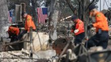 Search on for dozens missing in California wildfires as evacuees return home