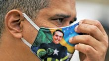 Bolsonaro fans applaud his maverick virus response