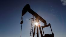 Oil prices inch higher on output cut support, but U.S. coronavirus spike caps gains